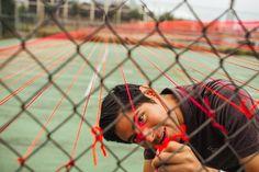 Eric Rieger, HOTTEA, rejuvenated tennis court, colorful yarn street art, Minneapolis street art, non-destructive street art,
