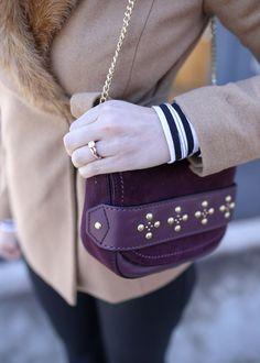 Maroon colored small handbag