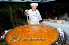 Chef Garcia cooking a big Paella Marinera for a big event. Paella Marinera is made out seafood . Fish, Lobsters,Stones crab , scallop , shrimp , octopus .