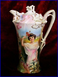 Beautiful Pitcher  This is RS Prussia, a German porcelain. This piece  represents the Spring season.
