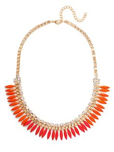 The two-tone beauty is a juicy summer treat, featuring uber-saturated shades of fuchsia and tangerine marquise gems attached to a glossy gold box chain.