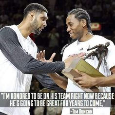 Spurs Tim Duncan & Kawhi Leonard share a moment.