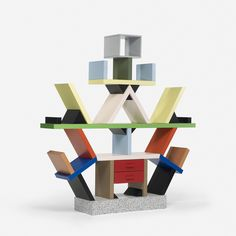 Carlton by Ettore Sottsass | Top 100 Furniture Selection | www.onehundrededition.com #hundred #onehundred #onehundrededition #design #luxury #interiordesign #shelf #topinteriordesigners #luxuryfurniture #exclusivedesign #designideas #furnituredesign #interiorprojects #projects #designinspirations #furniture #bestfurniture #chairs #tables #cabinets #lamps #furniturepieces #designindustry #art #design #contemporaryfurniture #moderndecor #furnitureideass #decor #decor #luxurybrand #luxurybrands…