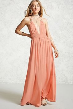 A woven fit and flare cami dress featuring a strappy back with cutouts, adjustable straps that self-ties at the back, an partial elasticized back waist, a round neckline, and a flowy skirt.
