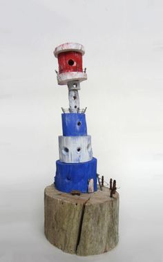 Blue and white lighthouse made from driftwood, Seven Heads Peninsula, West-Cork, Ireland.