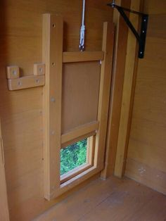 Chicken coop pop door