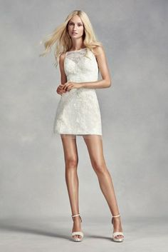 This shimmering short shift features an A-line skirt and illusion bib neckline,with metallic corded lace appliques as well as beaded organza applique on tulle over lace. Influenced by Jackie O in the late 60's in the South of France, this dress is perfect for a court house wedding, reception dance dress, a night on the town, or ceremony at the beach.  White by Vera Wang, exclusively for David's Bridal.  Check your local stores for availability.  Fully lined. Imported. Back zipper. Dry