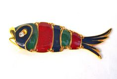 Colourful vintage 1970s articulated fish brooch in gold metal with a rhinestone eye and enamel panels in green, blue and red by LilyLovesEtsy on Etsy