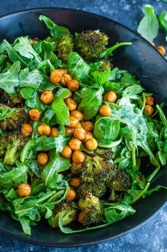 This tasty Roasted Broccoli Chickpea Arugula Salad is tossed with a healthy homemade lemon dressing and ready to rock your salad game! Gluten-Free + Vegan