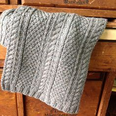 Free Knitting Pattern 4-Row Gansey Scarf - This textured scarf is knit with a 4 row repeat — even including the cables. Designed y Marji LaFreniere