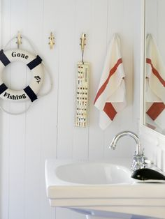 Don't know about the life preserver, etch but the nautical cleat hooks and striped towels would look nice in a bathroom