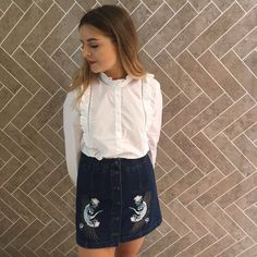Channel modern romance in this crisp white ruffle shirt. Style it with blue skinny jeans and black loafers for a polished look. #Topshop
