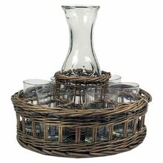 "Perfect for serving sangria at your next soiree, this woven willow basket holds 6 drinking glasses and a coordinating carafe.     Product: 1 Carafe, 6 glasses, and 1 basket   Construction Material: Glass and woven willow   Color: Clear and natural  Dimensions: 11.02"" H x 11.81"" Diameter (overall)   Cleaning and Care: Glasses are dishwasher safe, carafe must be hand washed and the basket can be wiped with a damp cloth"