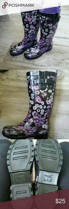 Capelli rainboots Black rubber boots with a white and purple daisy pattern and a size buckle.  Lined with confortable purple fabric.  Would fit a wider calf.  Size 7.  Never worn. Capelli of New York Shoes Winter & Rain Boots