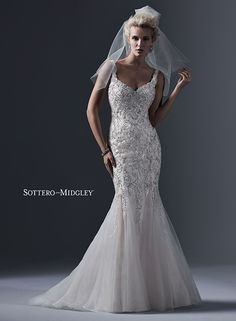 Dramatic tulle fit and flare wedding dress, adorned with sequins and sparkling Swarovski crystals, Holland by Sottero and Midgley.