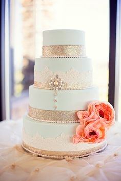 glitter tiered wedding cake with coral flowers @jazmines creative cakes Utah  Photography by http://effervescentmediaworks.com