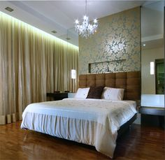 Modern Baroque Design | Modern Baroque design with golden wallpaper and heavy curtains.