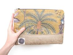 Ciré Vintage:  waxed vintage fabric pouch  by CIREonEtsy, £25.00
