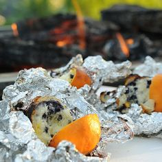 Love the Blueberry Oranges! cut orange in half and scoop out orange; mix up blueberry muffin mix per insstructions; fill one half of orange with mix and put the empty half on top. Wrap tightly in 3 layers aluminum foil. Through in fire - turn every minute and cook for 10.  Orange flavored blueberry muffins -eat with spoon top with ice cream or whipped cream.