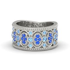 The Renaissance Band: 14K White Gold with Blue Topaz & Sapphire. Wide band ring that draws inspiration from the intricate stonework of Renaissance cathedrals / Gemvara