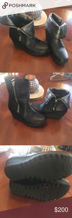 Fly London wedge boots Only wore a few times and are too small for me. Adorable!! Can be zipped up or peeled back for a different look. Extremely comfortable!! Fly London Shoes Heeled Boots
