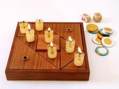 מנורת חנוכה   Hanukkah Menorah   Chanukiah from Tel Aviv   Modern Chanukah Menorah is a playful and modular gift for Hanukkah, consisting of 9 wooden candleholders.