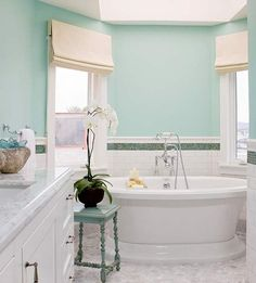 white tile and cabinets. Window coverings