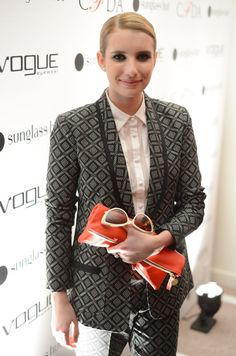 Emma Roberts Zip Around Clutch - Emma Roberts' zipper pouch red clutch was the perfect pop of color for her printed monochrome outfit.