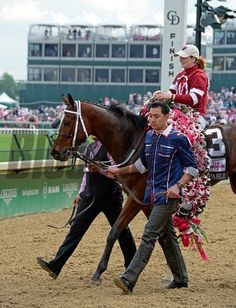 Lillies on board. Untapable with Rosie Napravnik wins the Kentucky OAKS. Kentucky Oaks day at Churchill Downs in Louisville, Ky., on May 2, 2014 Anne M. Eberhardt Photo