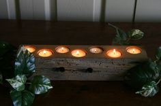 Candle holder made from an old barn beam