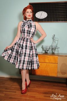 Streetcar Dress in Black and Red Plaid  - This 1950s inspired style in a fun, classic plaid features a flattering sleeveless top with a small Mandarin collar.  A whimsical, removable bow can be tied at the collar, but the keyhole neckline is adorable with or without.  A full fathered eight panel circle skirt with pockets and a skinny belt finish off this classic look!  Fully lined, side zipper.