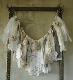 This Shabby Chic Fabric & Lace Garland would make a beautiful backdrop for a Bridal Shower, Wedding Ceremony / Reception, Birthday Party, Anniversary Celebration or most any Special Event. It could be hung on the wall or from a tree if outdoors; draped from the dessert or gift table; or could adorn the back of the Guest of Honors chair. As a home décor item it would look gorgeous adorning a fireplace mantle, hanging above a headboard or as a window valance just to name a few possibi...