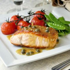 Pan Seared Salmon with Dijon Maple Butter Sauce - This simply seasoned and pan seared salmon gets served with a luscious, easy to make butter sauce made from just a few simple ingredients. This recipe is easily repaired in about 20 minutes making it suitable to do double duty as a worthy dinner party dish or a quick and easy workday dinner.
