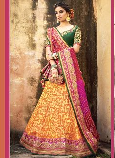 Exclusive collection & offers to buy bridal lehenga choli online for wedding. Buy this voluptuous green and orange jacquard silk lehenga choli.