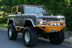 Ford Bronco | Reclaimed bronco in grey w/ orange roll bars etc Bronco Truck, Old Ford Bronco, Bronco Ii, Early Bronco, Jeep Truck, Classic Ford Broncos, Classic Bronco, Classic Trucks, Broncos Pictures