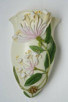 """Honeysuckle Wall Vase by Ibis & Orchid Wall Vase. $14.88. Outstanding detail and expertly hand painted describes our line of wall vases. Each one is beautifully sculpted, cast in bonded marble and expertly hand painted. This vase is approx 3.5"""" x 7"""" H. Nicely gift boxed with care instructions included. They look great as a solitary piece or get a matched set. Vibrant color will brighten any room. A Great gift for all occasions, each piece is glazed inside to be wa..."""