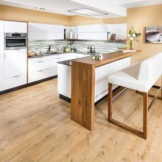 Designwohnküche in U-Form mit Bar und Hochbank