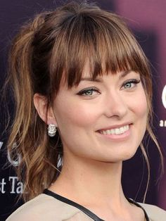 Choppy bangs: Olivia Wilde demonstrates a variation on Lea Michele's bangs here; they're full and straight across but with even more choppiness to break them up. These bangs look especially great with the beachy texture of the high ponytail, and a few longer strands pulled out to add softness around the face (without looking like prom tendrils).