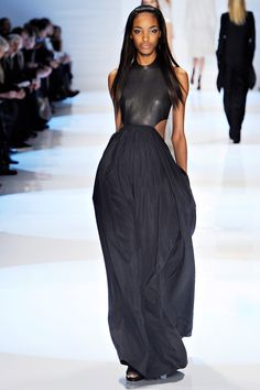 I'm so glad he did not add a collar or decoration of any sort to this.  It's so simple, in its best state.  Derek Lam