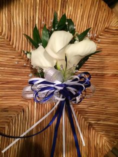 Royal blue and white calla lily prom corsage