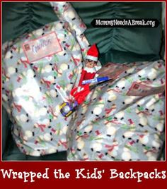 Elf on the Shelf Ideas ~ wrapped kids backpacks