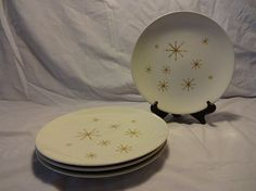 """Hey, hey, HEY atomic age! These great dinner plates are right out of the atomic period, with their gold starburst pattern. Very, very light crazing on a couple of these, but color is great and no chips.  Measures 10"""" wide."""