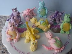 Can't believe my baby Hannah is turning 5 next week.  She has requested a dragon cake, and I've decided that all her little friends should be able to take a dragon home with them so i'm making 18 dragon cupcakes (9 down, 9 to go).  Hannah loves them and has chosen the pink one at the back. Jodie, my 6 year old wants the cheeky yellow one at the front :o) x