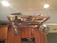 Old window repurposed over Kitchen Island to hold pots n' pans and kitchen tools or mugs