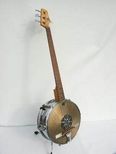 "Musical Upcycle - This handmade one of a kind stand-up bass guitar is an acoustic electric instrument custom made from a 14"" chrome snare drum, AXS Jazz Bass neck and cymbal. WANT IT, you can get it on Etsy"