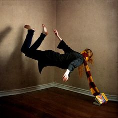 notice it's the deathly hallows from the Harry Potter series . and she's wearing a griffindor scarf