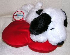 "Peanuts 12"" Plush Snoopy Laying on Heart Shaped Pillow Hallmark http://www.amazon.com/dp/B004UVRYEU/ref=cm_sw_r_pi_dp_nMDAwb02NE8SJ"