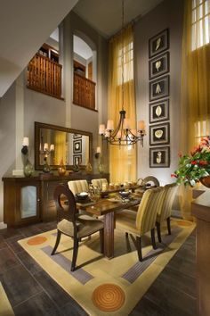Decorating very high walls covering windows from top to bottom and with artwork playing with the vertical Michael Trahan Interior Design.
