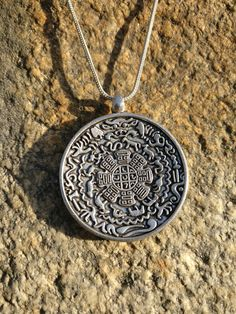 Just looking at the intricate details of the art work, proves the beauty of this handcrafted KALCHAKRA pendant - the wheel of time or the time-cycles of  life. Handmade jewelry,bohemian style, unique jewelry, spirituality, buddhism,made in the himalayas,bohemian jewelry, gypsy jewelry