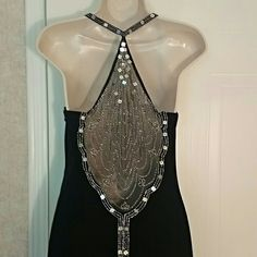 "*2 x HP* PROM Black Velvet Dave & Johnny Dress HP 10/22 & 5/27! PIC 1 is the back of this beautiful Dave and Johnny evening dress. Black velvet (polyester /spandex blend) with just a hint of beads on the front bodice but the back is the focal point. Sheer material encompasses beautiful beading and the beading goes all the way down the center of the dress to the hem. Absolutely gorgeous! Has slim liner inside. Measures 56"" from bodice at strap. 35"" from underarm to underarm. Approx waist…"